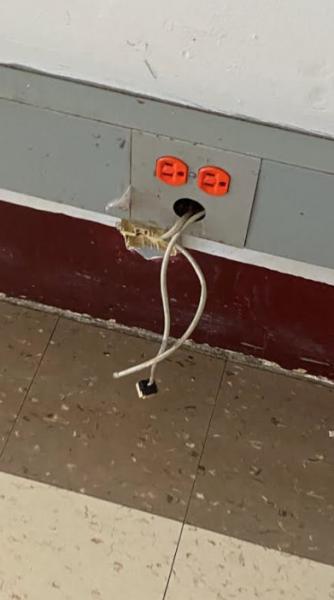 Broken-electrical-outlet-JFK
